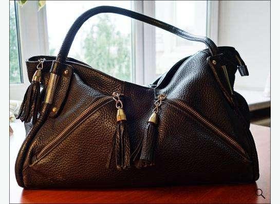 Продам черную кожаную сумку фирмы Терган