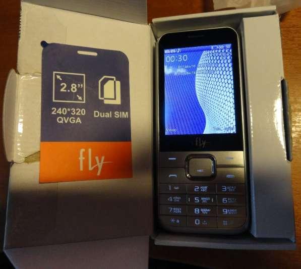2 телефона- FLY (смартфон и кнопочный) -Оба на 2 sim
